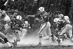 Baltimore Colts Johnny Unitas passing with protection against the Oakland Raiders #85 Carlton Oats.<br /> (photo 1960's/Ron Riesterer)