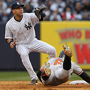 Derek Jeter, New York Yankees, making the tag at second for the out on Jonathan School, Orioles, in the fourth inning during the New York Yankees V Baltimore Orioles home opening day at Yankee Stadium, The Bronx, New York. 7th April 2014. Photo Tim Clayton
