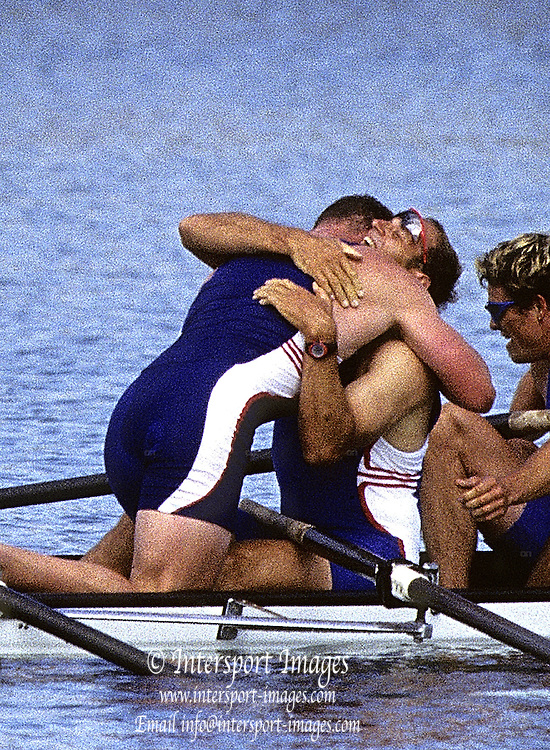 Sydney Olympics 2000 - Penrith Lakes, NSW. GBR M4- after crossing the finishing line, celebrate winning the Olympic Gold Medal Matthew Pinsent, climbs over to give Steve Redgrave, an enbrace.  © 2000 All Rights Reserved - Peter Spurrier Sports Photo. .Tel 44 (0) 1784-440 771  .Mobile 44 (0) 973 819 551.email images@intersport-images.com 2000 Olympic Regatta Sydney International Regatta Centre (SIRC) 2000 Olympic Rowing Regatta00085138.tif
