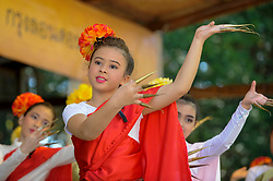© Licensed to London News Pictures. 09/04/2017. London, UK.  Young dancers in traditional costume perform on stage.  Worshippers and visitors attend the Thai New Year festival of Songkran at The Buddhapadipa Temple in Wimbledon.  Traditionally, the sprinkling of water symbolises the washing away of the past, and water would have been gently poured onto elders, or images of Buddha.