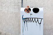 A comically painted face on a garbage can, Wroclaw, Poland.