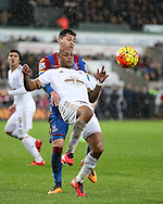 Andre Ayew of Swansea city tries an overhead shot at goal under pressure from Joel Ward of Crystal Palace. Barclays Premier league match, Swansea city v Crystal Palace at the Liberty Stadium in Swansea, South Wales on Saturday 6th February 2016.<br /> pic by Andrew Orchard, Andrew Orchard sports photography.