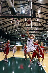 10 January 2009: Hope Schulte gets past Carlie Janowiak for a lay up. The Illinois Wesleyan Titans, ranked #1 in the latest USA Today/ESPN poll, take down the Lady Reds of Carthage and remain undefeated,  2-0 in the CCIW and over all to 12-0. This is the first time in the history of the Lady Titans Basketball they have been ranked #1 The Titans and Lady Reds played in the Shirk Center on the Illinois Wesleyan Campus in Bloomington Illinois.