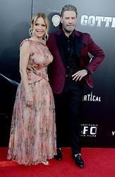 "Kelly Preston and John Travolta at the premiere of ""Gotti"" in New York City."