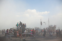 Burners explore the debris and ashes the morning after the Man Burn 2016.
