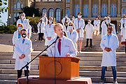 01 AUGUST 2020 - DES MOINES, IOWA: Dr. AUSTIN BAETH speaks at the Iowa State Capitol Saturday. About 50 doctors, medical professionals, and public health professionals from across Iowa came to the State Capitol to demand that Iowa Governor Kim Reynolds impose a mask mandate to control the spread of the coronavirus (SARS-CoV-2). Despite the continued spread of the coronavirus and rapidly increasing infection rate for COVID-19, the Governor has refused to impose a mask mandate or close businesses. For the week ending Saturday, Aug. 1, Iowa reported new 2,736 new cases of COVID-19.            PHOTO BY JACK KURTZ