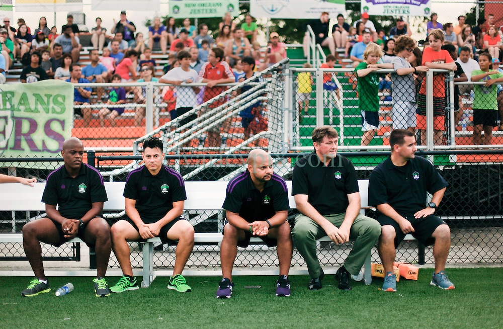 13 June 2015. New Orleans, Louisiana.<br /> National Premier Soccer League. NPSL. <br /> Manager Kenny Farrell (2nd rt) leads the bench in the minutes before kick off. The New Orleans Jesters play against Texas' Premier Soccer League's (TPSL) runner-up, Houston Hurricanes at home in the Pan American Stadium. Jesters take a 3-1 victory at the final whistle. <br /> Photo; Charlie Varley/varleypix.com