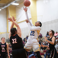 Zuni's Kari Kallestewa (22) drives to the basket as Hatch Valley's Katie Dunnahoo (32) defends Saturday during the championship game of the Rehoboth Christian High School girls basketball tournament in Rehoboth.