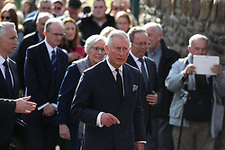 The Prince of Wales (centre) arrives for a visits the Aberfan Memorial Garden in Wales, on the 50th anniversary of the Aberfan disaster.