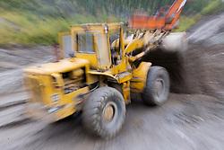 Heavy equipment works on a placer mine in the Klondike near Dawson City, Yukon