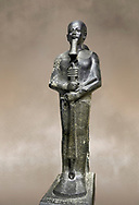 Ancient Egyptian statue of the god Ptah, granodiorite, New Kingdom, 18th Dynasty, (1390-1353 BC)Karnak. Egyptian Museum, Turin. <br /> <br /> The statue of the god Ptah is in the likeness of the reigning king Amenhotep III with a youthful almost feminine face, full cheeks, large smiling mouth and fleshy lips. The large almond shaped eyes are characteristic of the period as is the outline of the lips, Drovetti collection. Cat 86 .<br /> <br /> If you prefer to buy from our ALAMY PHOTO LIBRARY  Collection visit : https://www.alamy.com/portfolio/paul-williams-funkystock/ancient-egyptian-art-artefacts.html  . Type -   Turin   - into the LOWER SEARCH WITHIN GALLERY box. Refine search by adding background colour, subject etc<br /> <br /> Visit our ANCIENT WORLD PHOTO COLLECTIONS for more photos to download or buy as wall art prints https://funkystock.photoshelter.com/gallery-collection/Ancient-World-Art-Antiquities-Historic-Sites-Pictures-Images-of/C00006u26yqSkDOM