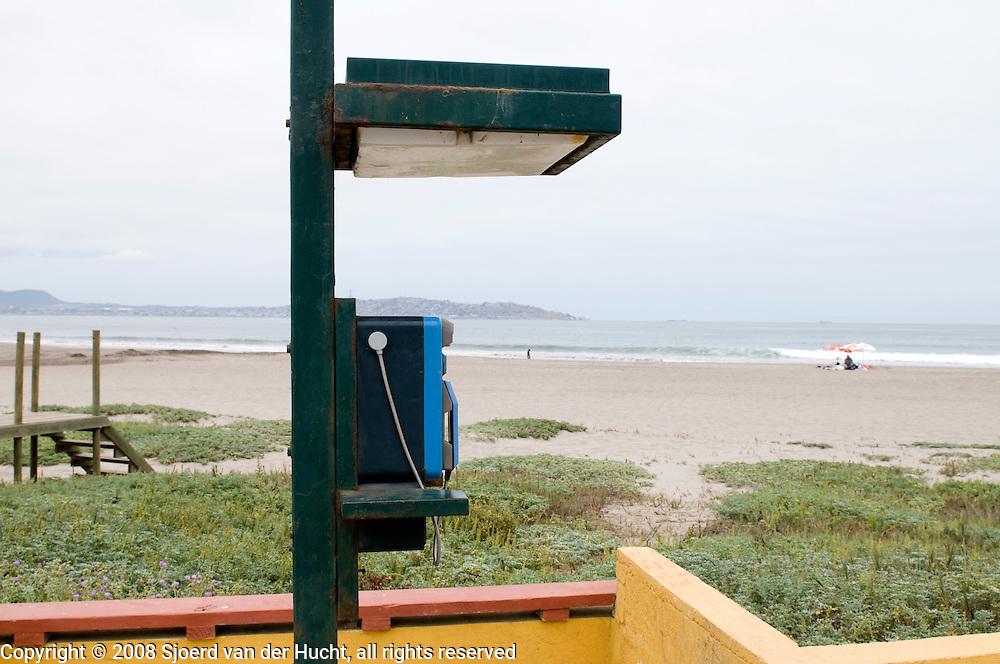 Public telephone at the beach of la Serena, Chile