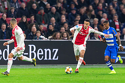 13-03-2019 NED: Ajax - PEC Zwolle, Amsterdam<br /> Ajax has booked an oppressive victory over PEC Zwolle without entertaining the public 2-1 / Noussair Mazraoui #12 of Ajax, Kenneth Paal #5 of PEC Zwolle