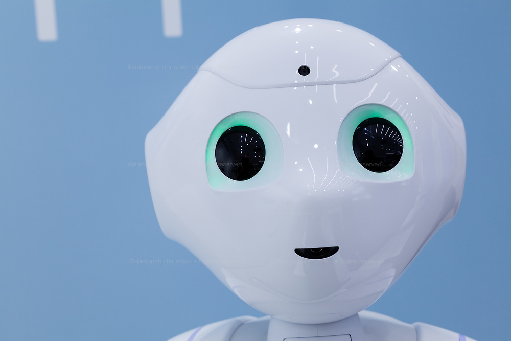 A portrait of Softbank's emotional consumer Robot, Pepper on display at the Softbank Store Omotesando, Tokyo, Japan. Friday August 1st 2014.  At the end of June 2021 the Softbank company announced it was cutting jobs in its global robotics business and had stopped production of the Pepper robot.