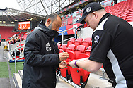 Wolverhampton Wanderers manager Nuno Espirito Santo signs his autograph for a fan before the The FA Cup 5th round match between Bristol City and Wolverhampton Wanderers at Ashton Gate, Bristol, England on 17 February 2019.