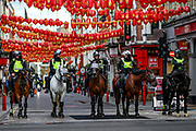 British mounted police officers try to contain members of the Far-Right Group during a protest at China Town, in central London, Saturday, June 13, 2020. British police have imposed strict restrictions on groups protesting in London Saturday in a bid to avoid violent clashes between protesters from the Black Lives Matter movement, as well as far-right groups that gathered to counter-protest.<br /> Anger against systemic levels of institutional racism has raged through the city, and worldwide; sparked by the death of George Floyd, who was killed in Minneapolis, US, by a policeman who restrained him with force on 25 May 2020. (Photo/ Vudi Xhymshiti)