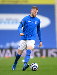 Brighton and Hove Albion's Adam Webster warming up prior to kick-off during the Premier League match at the American Express Community Stadium, Brighton. Picture date: Saturday May 15, 2021.