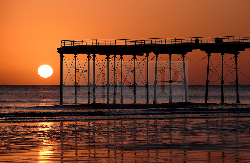 © Licensed to London News Pictures. <br /> 03/05/2016. <br /> Saltburn by the Sea, UK. <br /> <br /> The sun rises over the beach and pier at Saltburn by the Sea in North Yorkshire.<br /> <br /> Photo credit: Ian Forsyth/LNP
