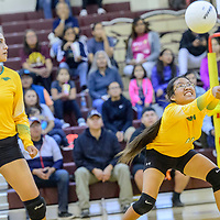 Newcomb Skyhawk Shoshanna Jones (4), right, leans to volley while playing the Tohatchi Cougars at Tohatchi High School Thursday.
