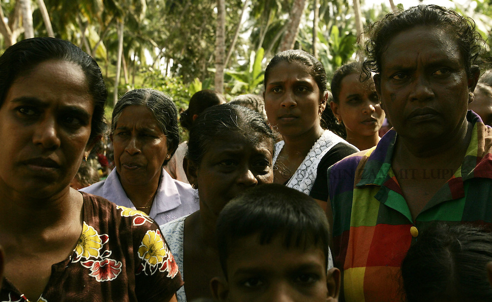 Tension begins to show on people's faces as it becomes clear food supplies won't be dropped off at the displaced persons camp at the Weheragalla Temple for public safety reasons in Mirissa January 15, 2005..Photo by Darrin Zammit Lupi