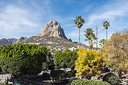 View of the Pena de Bernal monolith from the beautiful colonial village of Bernal, Queretaro, Mexico. Bernal is a quaint colonial town known for the Pena de Bernal, a giant monolith which dominates the tiny village is the third highest on the planet.