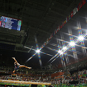Gymnastics - Olympics: Day 2   Gabrielle Douglas #392 of the United States performing her routine on the Balance Beam during the Artistic Gymnastics Women's Team Qualification round at the Rio Olympic Arena on August 7, 2016 in Rio de Janeiro, Brazil. (Photo by Tim Clayton/Corbis via Getty Images)<br /> <br /> (Note to editors: A special effects starburst filter was used in the creation of this image)