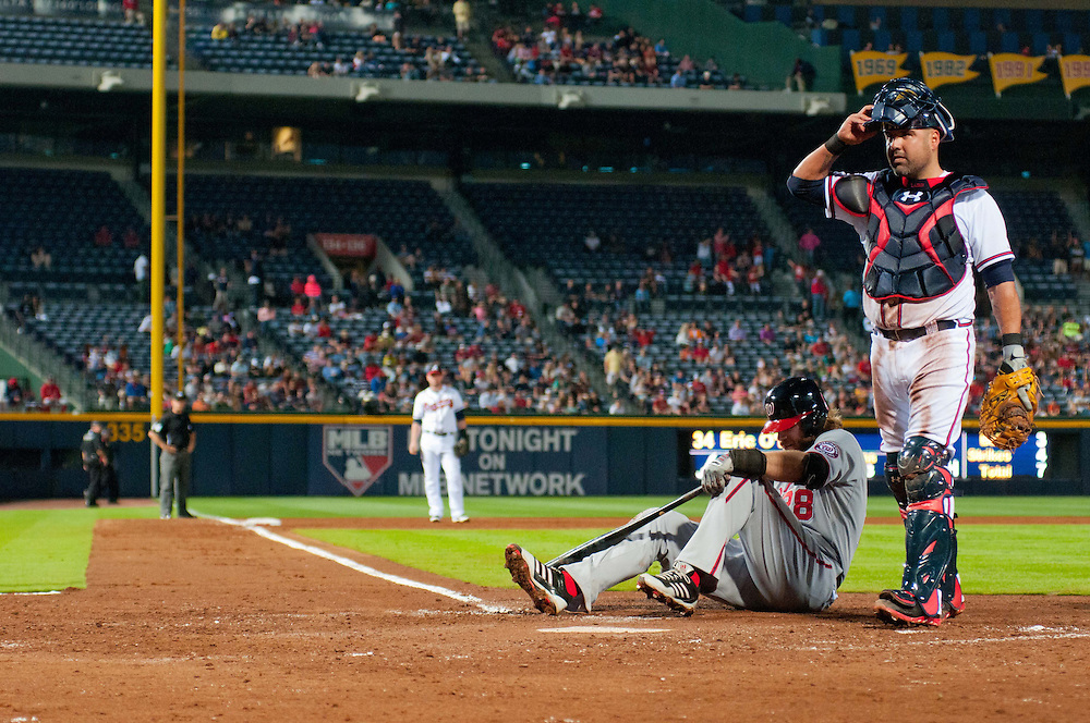 April 29, 2013, Atlanta, GA, USA; Washington Nationals right fielder Jayson Werth (28) reacts after being hit by the ball as Atlanta Braves catcher Gerald Laird (11) watches at Turner Field. Photo by Kevin Liles / kevindliles.com