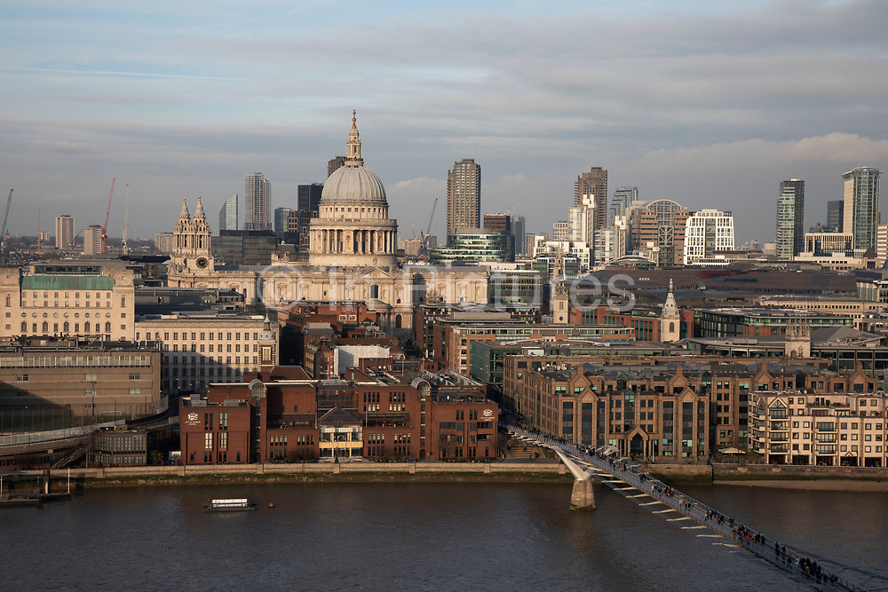 Cityscape skyline view over the River Thames and rooftops and River Thames towards St Pauls Cathedral in London, England, United Kingdom.