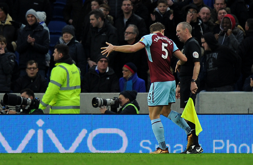 Burnley's James Tarkowski remonstrates with the linesman after conceding a penalty<br /> <br /> Photographer Ashley Western/CameraSport<br /> <br /> The Premier League - Brighton and Hove Albion v Burnley - Saturday 16th December 2017 - The Amex Stadium - Brighton<br /> <br /> World Copyright © 2017 CameraSport. All rights reserved. 43 Linden Ave. Countesthorpe. Leicester. England. LE8 5PG - Tel: +44 (0) 116 277 4147 - admin@camerasport.com - www.camerasport.com