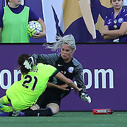 Orlando Pride goalkeeper Ashlyn Harris (1) gets tackled in the box by Seattle Reign FC defender Michelle Cruz (21) during a NWSL soccer match at Camping World Stadium on May 8, 2016 in Orlando, Florida. (Alex Menendez via AP)
