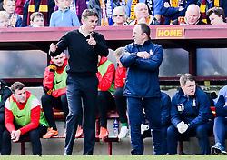 Bradford City Manager, Phil Parkinson talks with assistant Manager Steve Parkin - Photo mandatory by-line: Matt McNulty/JMP - Mobile: 07966 386802 - 07/03/2015 - SPORT - Football - Bradford - Valley Parade - Bradford City v Reading - FA Cup - Quarter Final