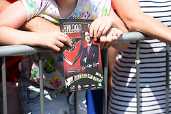 A fan holds a copy of The Wood matchday programme as the teams arrive