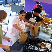 071613       Brian Leddy<br /> Kitchen Manager Vicky Espino helps pack lunches for area schools at Miyamura High School Tuesday morning. Each morning, employees pack lunches for dozens of schools in the McKinley County district.
