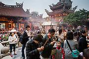 Worshipers go through religious rituals at Longshan Temple in Taipei, Taiwan.