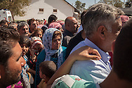 Syian Kurdish refugees that fled to Turkey days earlier, attempt to return to their homes whilst Islamic State militants battle for control of the border town. Mürşitpınar border crossing, southern Turkey.