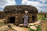 Togu na or casa palava in Djiguibombo. Usually located in the centre of each village or quarter, the togu na is a shelter reserved for men, where the elders hold meetings, councils and pronounce judgements. The millet-stalk roof is normally 1.2m from the ground to prevent  standing up. The Dogon Country is the most visited part of Mali with tourists visiting its tipical  villages that can be located on the cliff, on the sandy plain or in the rocky plateau