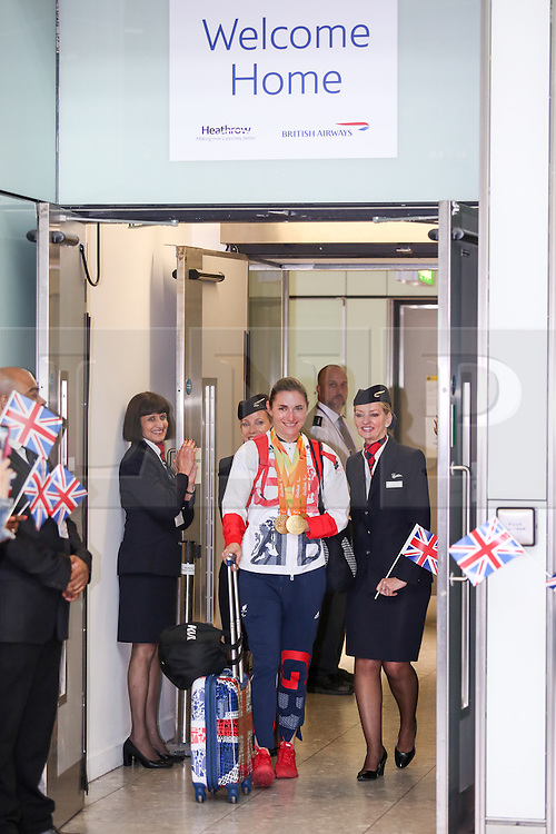 © Licensed to London News Pictures. 20/09/2016. London, UK. Team GB Paralympian DAME SARAH STOREY arrives at terminal 5 of London Heathrow Airport after flying on British Airways flight BA2016. Storey won 3 gold medals and is the most successful Paralympian of all time. Team GB finished second in the Paralympics medals table with 147 medals beating their total of 120 at London 2012. Photo credit : Tom Nicholson/LNP