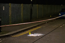© Licensed to London News Pictures. 20/01/2020. London, UK. An evidence identification marker sits next to an evidence bag covering an unknown item. Police cordoned off a road & park and searched a property approximately half a mile from the location where an investigation was launched into the deaths of three men in Redbridge, all of whom had suffered apparent stab injuries.. Photo credit: Peter Manning/LNP