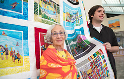 April 6, 2018 - Boynton Beach, Florida, U.S. - Suburban Boynton resident Jane Burke has handmade a quilt for Brandon Drucker (right), an artist who has autism and whose pictures fill this year's City of Boynton Beach calendar. Burke was inspired by Drucker's artwork and wants to teach others with autism how to make quilts in Boynton Beach, Florida on April 5, 2018. The quilt hangs in the lobby of  city hall this month. (Credit Image: © Allen Eyestone/The Palm Beach Post via ZUMA Wire)