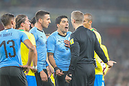 Uruguay forward Luis Suárez (9) argues with Referee, Craig Pawson after a penalty kick is awarded against his team during the Friendly International match between Brazil and Uruguay at the Emirates Stadium, London, England on 16 November 2018.