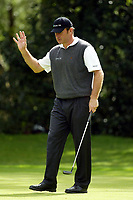 Photograph: Scott Heavey<br />Volvo PGA Championship At Wentworth Club. 23/05/2003.<br />Nick Faldo salutes the crowd after a crucial putt on the 12th