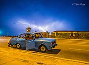 Havana, Cuba, broken car along La Cabana fortress and Morro Castle