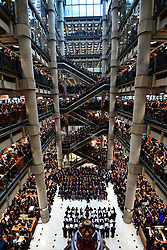 Staff line the atrium during the Lloyd's of London Armistice commemoration service.