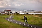 Old fishing Sheds on south shore with skater in foreground.