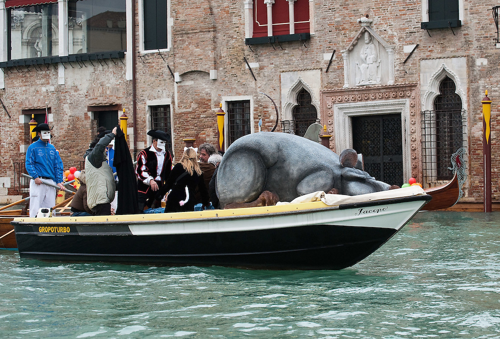 """VENICE, ITALY - FEBRUARY 20: A boat carrying the """"pantegana"""" (Mouse) sails along the Grand Canal during the Venetian Feast on February 20, 2011 in Venice, Italy. During the Venetian Feast a traditional water parade sails from San Marco along the Canal Grande to the  district of Cannaregio where there the crowd waits for the Svolo della Pantegana (flight of the mouse)."""
