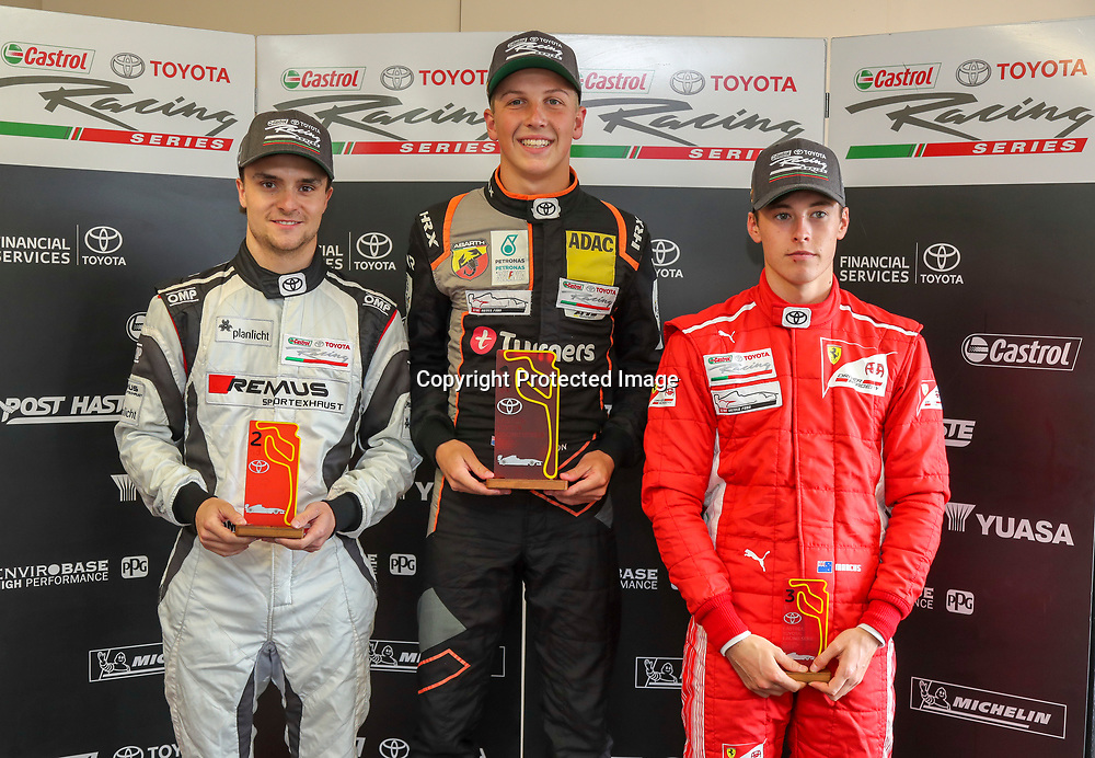 Lucas Auer (left) stands on the Podium next to Liam Lawson (centre) and Marcus Armstrong (right) whilst racing in the 2019 Castrol Toyota Racing Series in New Zealand, taken at Taupo on 2 February 2019