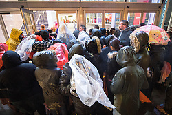 © Licensed to London News Pictures . 26/12/2015 . Manchester , UK . Bargain hunters push at the front of the queue in the rain outside Next at Manchester's Arndale Centre , for the 6am start of the annual winter sale . Photo credit: Joel Goodman/LNP
