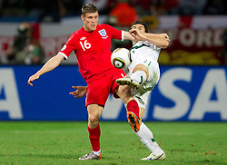 James Milner of England vs Bojan Jokic of Slovenia during the 2010 FIFA World Cup South Africa Group C Third Round match between Slovenia and England on June 23, 2010 at Nelson Mandela Bay Stadium, Port Elizabeth, South Africa.  (Photo by Vid Ponikvar / Sportida)