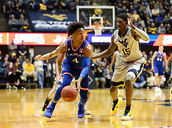 Jan 15, 2018; Morgantown, WV, USA; Kansas Jayhawks guard Devonte' Graham (4) dribbles out of pressure during the second half against the West Virginia Mountaineers at WVU Coliseum. Mandatory Credit: Ben Queen-USA TODAY Sports