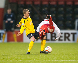 Falkirk's Craig Sibbald and Airdrie United's Chris O'Neil..half time : Airdrie United 1 v 4 Falkirk, 22/12/2012..©Michael Schofield.